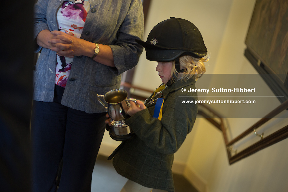 6year old Fraser Carsson, and elderly rider Liz Stuart, youngest and oldest riders on the day's ride-out, receive their trophies at the culmination of the Gala Braw Lads Gathering, in Galashiels, Scotland, Saturday 29th June 2013.<br /> N55&deg;36.862'<br /> W2&deg;48.388'