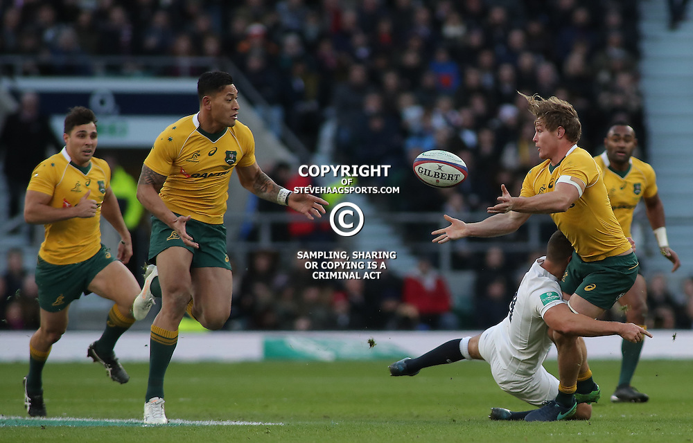 TWICKENHAM, ENGLAND - DECEMBER 03: Ben Youngs of England tackles Michael Hooper of Australia during the Old Mutual Wealth Series match between England and Australia at Twickenham Stadium on December 3, 2016 in London, England. (Photo by Mitchell Gunn/Getty Images) *** Local Caption ***Ben Youngs;Michael Hooper