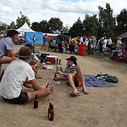 Locals drinking beer during the 50th Anniversary Glenorchy Race meeting. The races, which originally started in the 1920's, were resurrected in 1962 and have been run by local farmers and the rugby club on the first Saturday after New Years Day ever since. Glenorchy, Otago, New Zealand. 7th January 2012