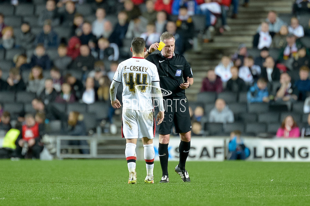 MK Dons forward Jake Forster-Caskey gets a yellow card during the Sky Bet Championship match between Milton Keynes Dons and Wolverhampton Wanderers at stadium:mk, Milton Keynes, England on 5 April 2016. Photo by Dennis Goodwin.