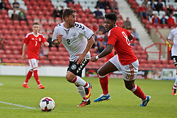 WREXHAM, WALES - Friday, September 2, 2016: Wales' Ellis Harrison in action against Denmark's Frederik Holst during the UEFA Under-21 Championship Qualifying Group 5 match at the Racecourse Ground. (Pic by Paul Greenwood/Propaganda)