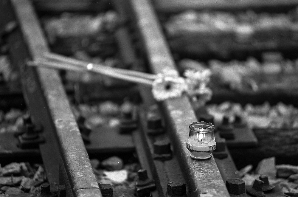 Candles on the railroad track at the Auschwitz (Birkenau) Nazi concentration camp. It is estimated that between 1.1 and 1.5 million Jews, Poles, Roma and others were killed here in the Holocaust between 1940-1945.