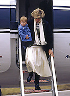 PRINCE HARRY_30 years on<br /> Diana, Princess of Wales carries baby Prince Harry when they arrived at Aberdeen Airport on their way to Balmoral in March 1986.<br /> Prince Harry celebrates his 30th birthday on the 15th of September 2014<br /> Mandatory Photo Credit: &copy;Dias/NEWSPIX INTERNATIONAL<br /> <br /> Mandatory credit photo:NEWSPIX INTERNATIONAL(Failure to credit will incur a surcharge of 100% of reproduction fees)<br /> <br /> **ALL FEES PAYABLE TO: &quot;NEWSPIX INTERNATIONAL&quot;**<br /> <br /> Newspix International, 31 Chinnery Hill, Bishop's Stortford, ENGLAND CM23 3PS<br /> Tel:+441279 324672<br /> Fax: +441279656877<br /> Mobile:  07775681153<br /> e-mail: info@newspixinternational.co.uk