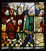 How a Jewish man finds his defrauded money and converts to Christianity, from a series of windows of the Life of St Nicholas in the Legende Doree or Golden Legend, by Jacques de Voragine, early 13th century, in the Chapelle Notre-Dame in the Eglise Notre-Dame de Caudebec-en-Caux, a Flamboyant Gothic catholic church built 15th and 16th centuries, in Caudebec-en-Caux, Normandy, France. The church is listed as a historic monument. Picture by Manuel Cohen