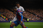 Jason Puncheon holds off Kyle Naughton during the Barclays Premier League match between Crystal Palace and Swansea City at Selhurst Park, London, England on 28 December 2015. Photo by Michael Hulf.