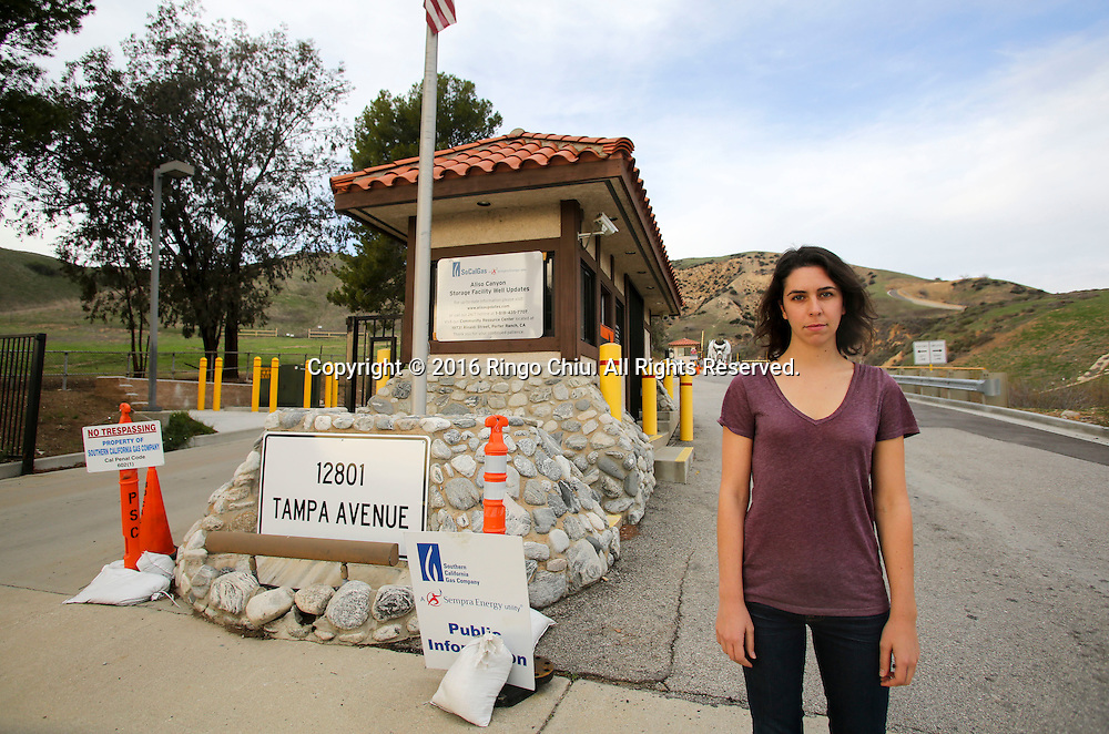 Alex Nagy, an activist from Food &amp; Water Watch, who helps Porter Ranch residents to relocate and fight for their rights against gas company, stand at the entrance of the Southern California Gas Company, Aliso Canyon storage facility at the Porter Ranch area.<br /> (Photo by Ringo Chiu/PHOTOFORMULA.com)<br /> <br /> Usage Notes: This content is intended for editorial use only. For other uses, additional clearances may be required.