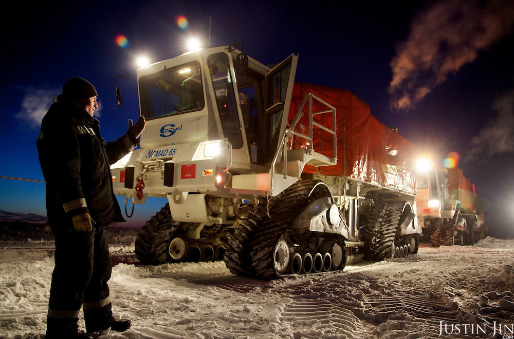 "A worker from seismic exploration company  guides an all-terrain seismic exploration vehicle in the Arctic tundra. The vehicle, called a ""vibrator"", is made by a French company and uses seismic vibration to test the structure of the earth crust below to help prospect for oil and gas. Four billion tonnes of gas and oil have been found in the region in the last decade."