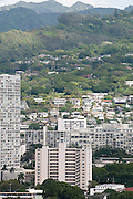 A vertical photo of Barack Obama's childhood apartment building in Makiki, Honolulu.