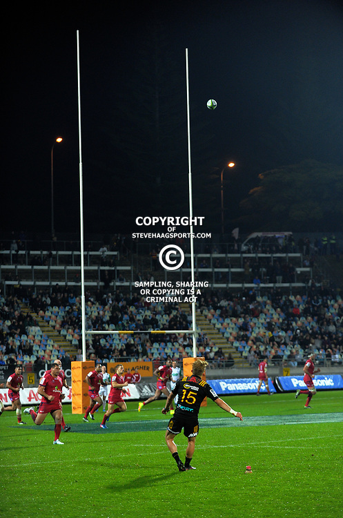 Damien McKenzie kicks for goal during the Super Rugby match between the Chiefs and Reds at Yarrow Stadium in New Plymouth, New Zealand on Saturday, 6 May 2017. Photo: Dave Lintott / lintottphoto.co.nz