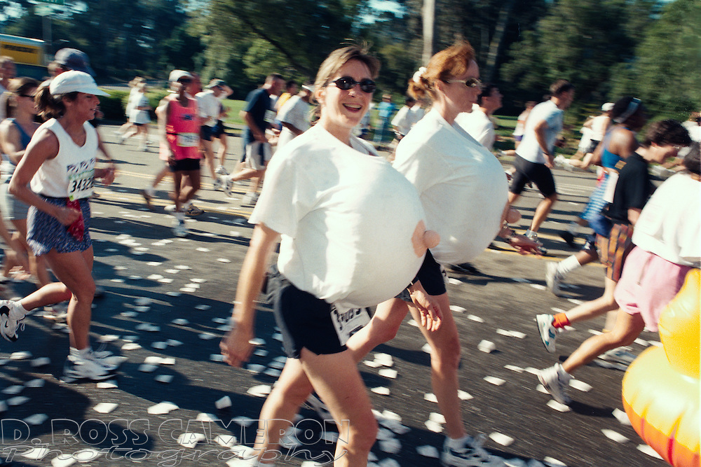 Two unidentified women costumed as a pair of breasts walk through Golden Gate Park at the 86th running of the Bay to Breakers 12K footrace, Sunday, May 18, 1997 in San Francisco. (Photo by D. Ross Cameron)