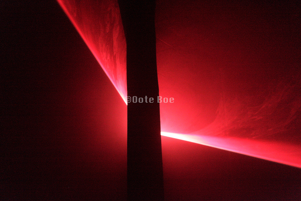 a laser light beam being split by an pillar