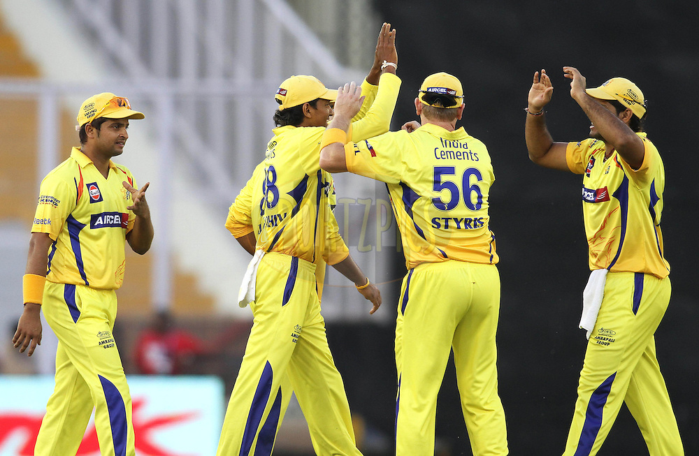 Chennai Super Kings celebrate Captain Adam Gilchrist of the Kings XI Punjab wicket during match 9 of the Indian Premier League ( IPL ) Season 4 between the Kings XI Punjab and the Chennai Super Kings held at the PCA stadium in Mohali, Chandigarh, India on the 13th April 2011..Photo by Shaun Roy/BCCI/SPORTZPICS