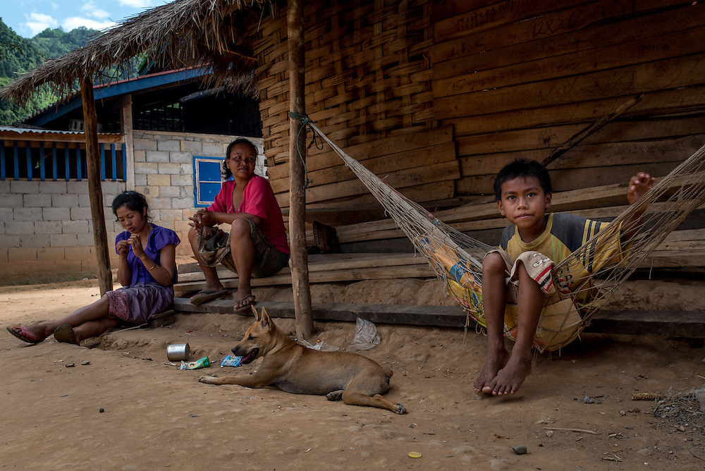 Residents of the village of Khoc Kham relax during the mid day heat.