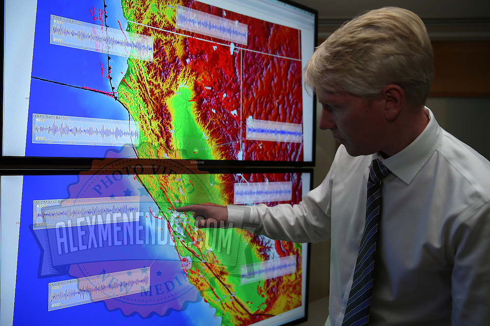 Richard M. Allen, Director of the Berkeley Seismological Laboratory points out aftershock areas on a map in his office in Berkeley, California, on Monday, August 24, 2014.  On Sunday, a 6.1 magnitude earthquake caused significant damage and left three critically injured in California's northern Bay Area early Sunday, igniting fires, sending at least 87 people to a hospital, knocking out power to tens of thousands and sending residents running out of their homes in the darkness. Aftershocks are still being captured across the area by seismometers that are recording seismic data. (AP Photo/Alex Menendez)