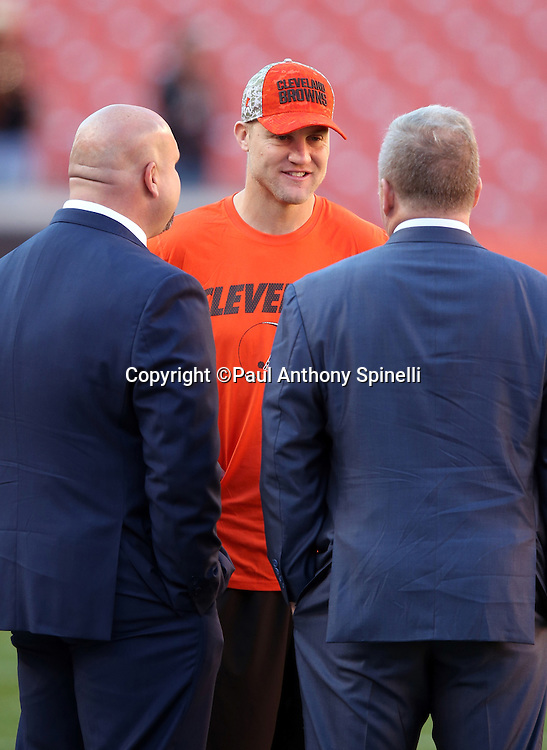 (L-R) Arizona Cardinals general manager Steve Keim talks to Cleveland Browns quarterback Josh McCown (13) and another team executive before the 2015 week 8 regular season NFL football game against the Cleveland Browns on Sunday, Nov. 1, 2015 in Cleveland. The Cardinals won the game 34-20. (©Paul Anthony Spinelli)