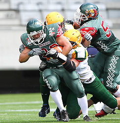 10.07.2011, Tivoli Stadion, Innsbruck, AUT, American Football WM 2011, Group A, Mexico (MEX) vs Australia (AUS), im Bild Reyes José (Mexico, #22, RB) gets stopped by australians defense // during the American Football World Championship 2011 Group A game, Mexico vs Australia, at Tivoli Stadion, Innsbruck, 2011-07-10, EXPA Pictures © 2011, PhotoCredit: EXPA/ T. Haumer