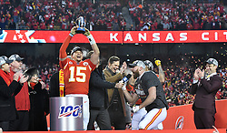 Jan 19, 2020; Kansas City, Missouri, USA; Kansas City Chiefs owner Clark Hunt and head coach Andy Reid and Lamar Hunt's daughter Norma Hunt and Kansas City Chiefs quarterback Patrick Mahomes (15) and CBS sportscaster Jim Nantz  and tight end Travis Kelce (87) and general manager Brett Veach (left to right) celebrate on stage after the AFC Championship Game against the Tennessee Titans at Arrowhead Stadium. Mandatory Credit: Denny Medley-USA TODAY Sports