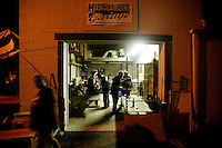 Harley Davidson bikers at the Milwaukee Garage, work on a custom bike late into the nite Tuesday Aug. 26, 2003 Milwaukee in preperation for the Harley Davidson 100th anniversary celebration.   photo by Darren Hauck