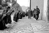 China, Xiahe, 2005. A welcome home to an important elder is marked by painted sand patterns and monks in attendance..