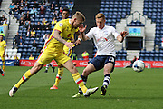 Preston North End Striker Eoin Doyle battles during the Sky Bet Championship match between Preston North End and Milton Keynes Dons at Deepdale, Preston, England on 16 April 2016. Photo by Pete Burns.