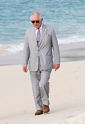 The Prince of Wales walks along the Grand Anse beach during a one day visit to the Caribbean island of Grenada.