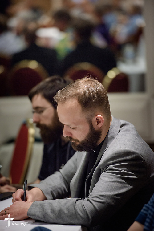 Attendees listen and jot notes during the Operation Barnabas conference event on Thursday, March 15, 2018, at the Hilton St. Louis Airport hotel in St. Louis. LCMS Communications/Erik M. Lunsford
