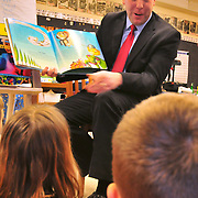 "3/2/10 -- BATH, Maine. Maine's District 19 Representative Seth Goodall (D-Richmond) came to Dike Newell Elementary in Bath on Tuesday morning to read to Wanda Brown's 1st grade class. Rep. Goodall read one of his mother's favorite books, ""Michael Recycle"",  by Ellie Bethel. He spoke with the children about the work he's doing at the State House to improve recycling in Maine. Many of the children were well-versed in recycling efforts and had good questions for the District 19 rep. Photo by Roger S. Duncan"