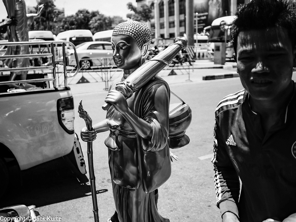 10 APRIL 2017 - BANGKOK, THAILAND: Workers deliver statues of the Buddha to shops on Thanon Bamrung Mueang in Bangkok. The street is the center of the Buddhist supply shops in Bangkok.        PHOTO BY JACK KURTZ