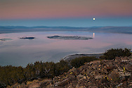 Full moon rising over Mono Lake in the evening; Mono County; Eastern Sierra; California