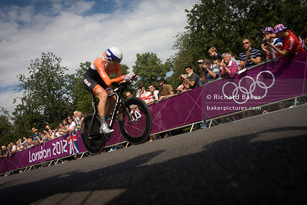 A Dutch cyclist races past fans lining the route through Bushy Park in south west London, during the London 2012 Olympic 44km men's cycling time trial, eventually won by Team GB's Bradley Wiggins.