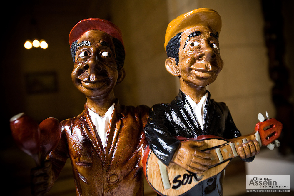 Wooden statues of musicians for sale inside the national capitol building in Havana, Cuba on Thursday June 26, 2008.
