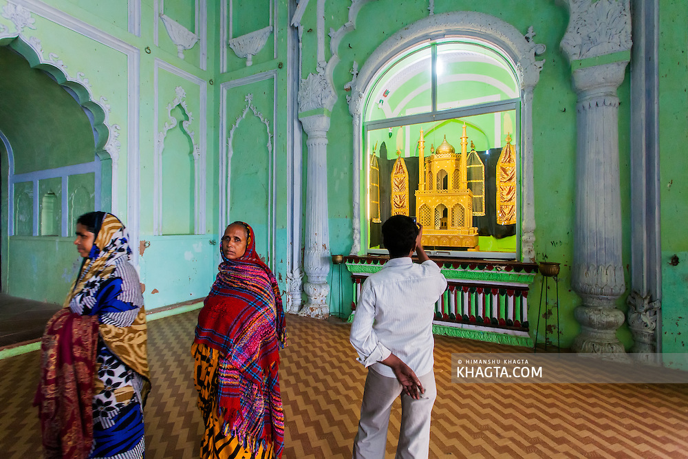 A tourist takes a picture with his cell phone inside the heritage building of Bara Imambara built by Asaf-ud-Daula, Nawab of Awadh, in 1784. It is also called the Asafi Imambara. Imambara is a shrine built by Shia Muslims for the purpose of Azadari.