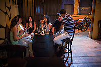 Medellin, Colombia- March 13, 2015: A group of friends share a laugh over beers at the craft brewery Cerveceria Libre. Craft beer is a relatively new trend in Colombia and the owners at Cerveceria Libre are helping to raise the tide by serving beers of the countries other craft offerings Apostol, Bogota Brewing Company, and 3 Cordilleras. CREDIT: Chris Carmichael for The New York Times