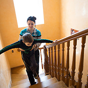 Kirill can barely walk after his cancer surgeries and depends on his mother Natasha for his mobility