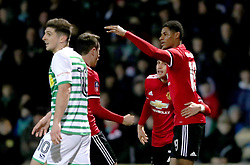 Manchester United's Marcus Rashford (right) celebrates scoring his side's first goal of the game during the Emirates FA Cup, fourth round match at Huish Park, Yeovil.