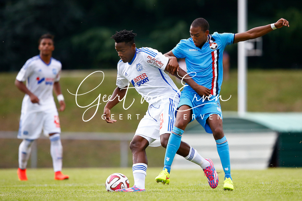 Onderwerp/Subject: Olympique Marseille - Willem II - Friendly<br /> Reklame:  <br /> Club/Team/Country: <br /> Seizoen/Season: 2014/2015<br /> FOTO/PHOTO: Michy BATSHUAYI (L) of Olympique Marseille in duel with Fabian SPORKSLEDE ( Fabian Mitchel SPORKSLEDE ) (R) of Willem II. (Photo by PICS UNITED)<br /> <br /> Trefwoorden/Keywords: <br /> #04 $94 &plusmn;1405930080633<br /> Photo- &amp; Copyrights &copy; PICS UNITED <br /> P.O. Box 7164 - 5605 BE  EINDHOVEN (THE NETHERLANDS) <br /> Phone +31 (0)40 296 28 00 <br /> Fax +31 (0) 40 248 47 43 <br /> http://www.pics-united.com <br /> e-mail : sales@pics-united.com (If you would like to raise any issues regarding any aspects of products / service of PICS UNITED) or <br /> e-mail : sales@pics-united.com   <br /> <br /> ATTENTIE: <br /> Publicatie ook bij aanbieding door derden is slechts toegestaan na verkregen toestemming van Pics United. <br /> VOLLEDIGE NAAMSVERMELDING IS VERPLICHT! (&copy; PICS UNITED/Naam Fotograaf, zie veld 4 van de bestandsinfo 'credits') <br /> ATTENTION:  <br /> &copy; Pics United. Reproduction/publication of this photo by any parties is only permitted after authorisation is sought and obtained from  PICS UNITED- THE NETHERLANDS