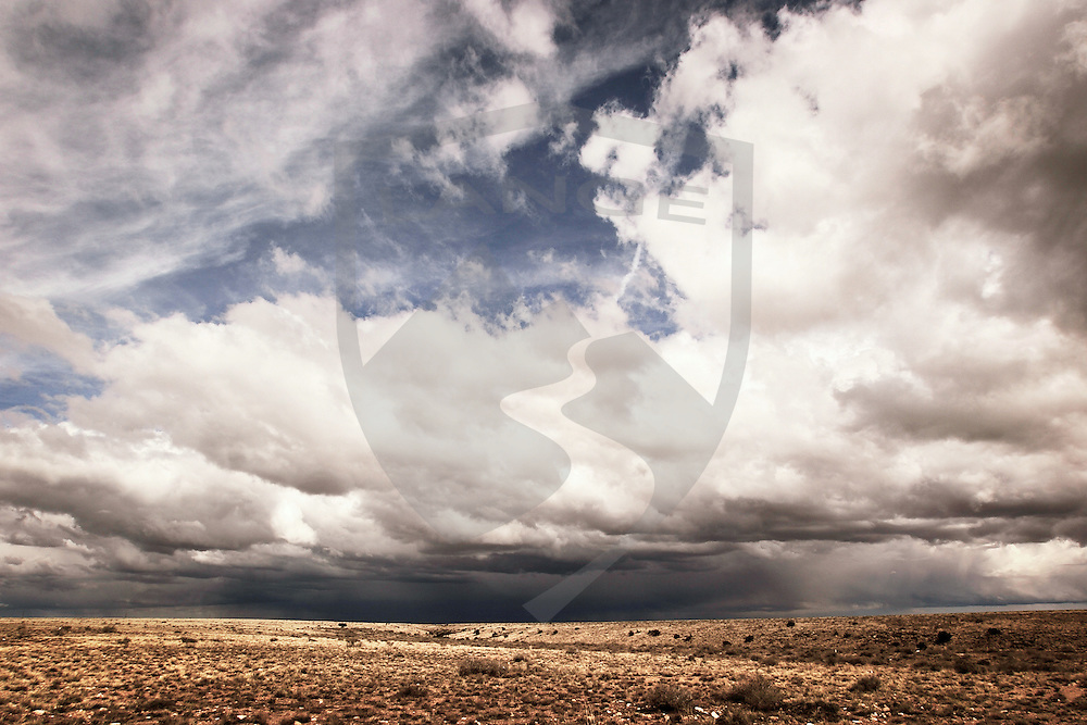nature scenery and travel: arizona cloudy sky and stark desert landscape abstract, along route 66, horizontal, copy space