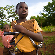 "Emanuel Nyanibo, 10, and her five-year-old brother ride Emanuel's bike to school near Savelugu, northern Ghana, on Monday June 4, 2007. ""My father bought me a bike in order for me to keep going to school,"" says Emanuel. ""He told me you have to keep going to school so that you can become president of Ghana one day."""