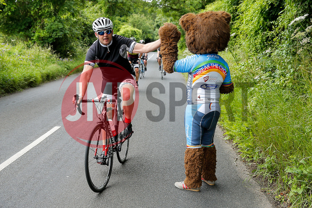 Cyclists are greeted by Brizzly the Bristol Rugby Mascot as they reach the top of Bannerdown Hill as they take part in Break The Cycle, a 111 mile charity bike ride organised by the Bristol Rugby and Gloucester Rugby Community Foundations - Mandatory byline: Rogan Thomson/JMP - 03/07/2016 - CYCLING - Bannerdown Road - Bath, England - Break The Cycle Challenge 2016.