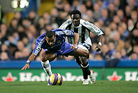 Photo: Marc Atkins.<br /> Chelsea v Newcastle United. The Barclays Premiership. 13/12/2006. Ashley Cole of Chelsea is fouled by Obafeme Martins of Newcastle.