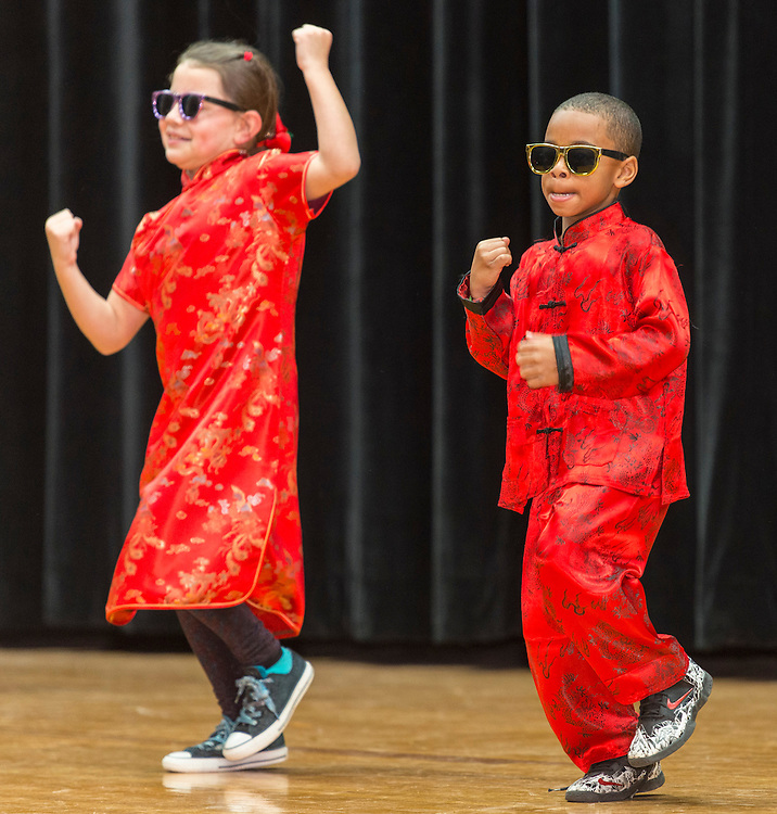 Mandarin Chinese Emersion School students perform during a district wide celebration of the Chinese New Year at Sharpstown International School, February 22, 2014.