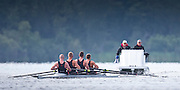 Canadian Olympic rowing coach Martin McElroy holds a megaphone while he and Strength and Conditioning coach Nick Clarke keep a close eye on the mens four that will represent Canada at the Rio Olympic games (left to right) Will Crothers,  Tim Schrijver, Conlin McCabe and Kai Langerfeld during a morning training session on Elk Lake in Victoria, British Columbia on June 22, 2016.