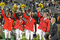 Team Belgium bronze medal<br /> Dirk Demeersman, Judy Ann Melchior, Jos Lansink, Philippe Lejeune<br /> Alltech FEI World Equestrian Games <br /> Lexington - Kentucky 2010<br /> © Dirk Caremans