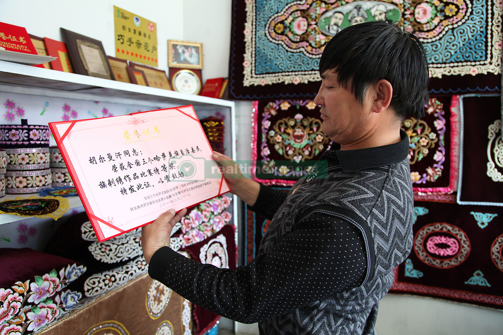 May 24, 2017 - China - Xinjiang, CHINA-May 23 2017: (EDITORIAL USE ONLY. CHINA OUT)..The Khazakstan man is good at making embroidery works in Balikun, northwest China's Xinjiang Uygur Autonomous Region. (Credit Image: © SIPA Asia via ZUMA Wire)