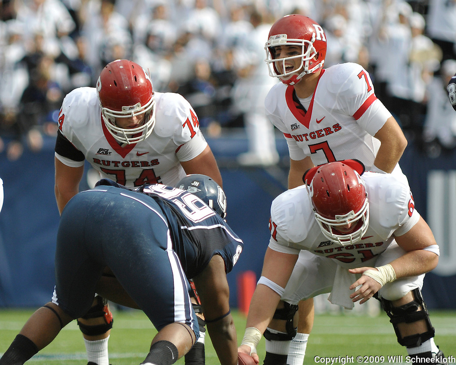 Oct 31, 2009; East Hartford, CT, USA; Rutgers quarterback Tom Savage (7) barks out instructions to offensive lineman Howard Barbieri (74) and center Ryan Blaszczyk (61) during first half Big East NCAA football action between Rutgers and Connecticut at Rentschler Field.