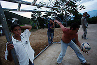 A game of vollyball in El Ofrio, a small remote village in the southern Colombian state of Nariño, on Saturday, June 23, 2007. There are coca fields located in the vicinity of El Ofrio, but the residents know that soon fumigation and manual eradication of their coca crops by the Colombian government will force them to find a new means to earn cash. (Photo/Scott Dalton)