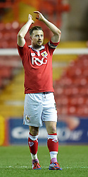 Bristol City captain Wade Elliott thanks supporters after City's 2-0 victory over Coventry City in Johnstone's Paint Trophy regional semi-final - Photo mandatory by-line: Paul Knight/JMP - Mobile: 07966 386802 - 10/12/2014 - SPORT - Football - Bristol - Ashton Gate Stadium - Bristol City v Coventry City - Johnstone's Paint Trophy
