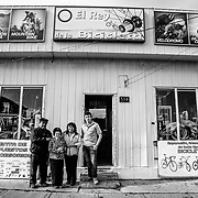 Andres Quenchugaray, Maria Verategua, Sandra Quenchugaray and Carlos Mansilla - Three generations of bike shop owners in Puerto Natales, Chile. The King of the Bicycle.