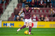 Steven MacLean (#18) of Heart of Midlothian FC scores the equalising goal during the Betfred Scottish Football League Cup quarter final match between Heart of Midlothian FC and Aberdeen FC at Tynecastle Stadium, Edinburgh, Scotland on 25 September 2019.