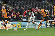 Marco Djuricin (8) of Brentford gets away from Hull City defender Alex Bruce (4)  during the Sky Bet Championship match between Hull City and Brentford at the KC Stadium, Kingston upon Hull, England on 26 April 2016. Photo by Ian Lyall.